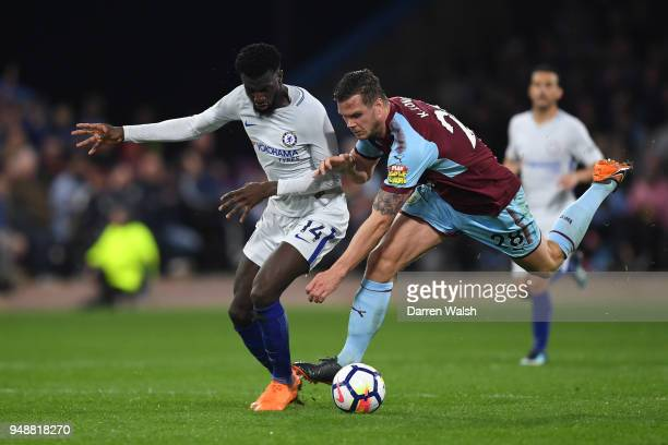 Kevin Long of Burnley challenges Tiemoue Bakayoko of Chelsea during the Premier League match between Burnley and Chelsea at Turf Moor on April 19...