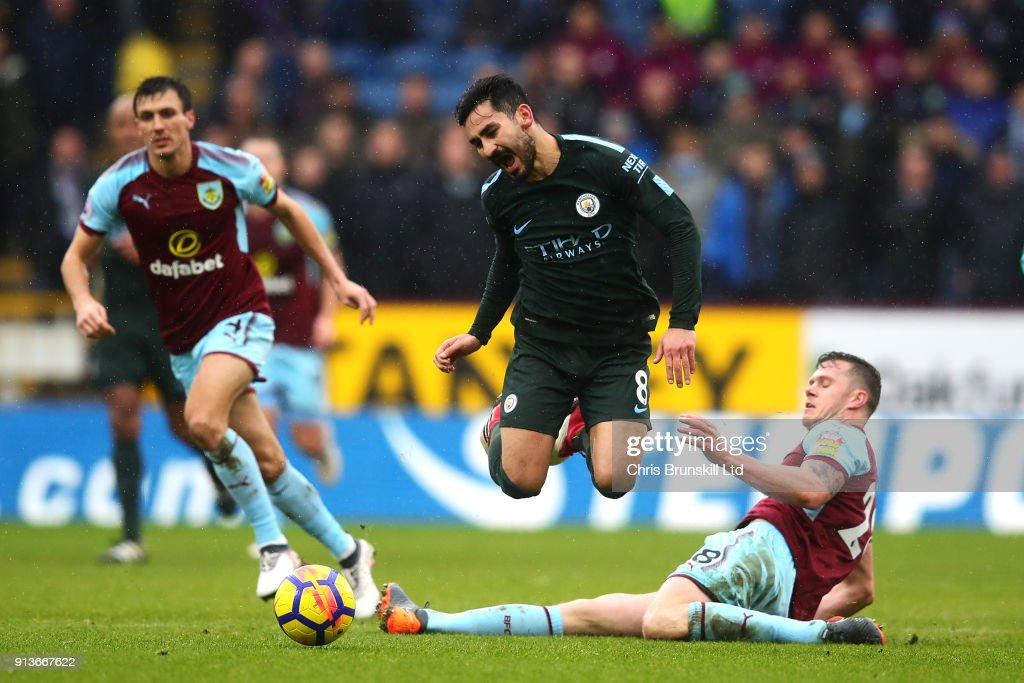 Kevin Long of Burnley foul Ilkay Gundogan of Manchester City during the Premier League match between Burnley and Manchester City at Turf Moor on February 3, 2018 in Burnley, England.