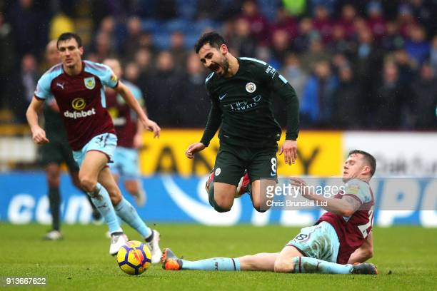 Kevin Long of Burnley foul Ilkay Gundogan of Manchester City during the Premier League match between Burnley and Manchester City at Turf Moor on...