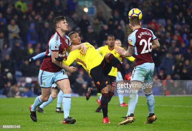 Kevin Long of Burnley holds back Richarlison de Andrade of Watford whilst Phil Bardsley of Burnley headers the ball clear during the Premier League...