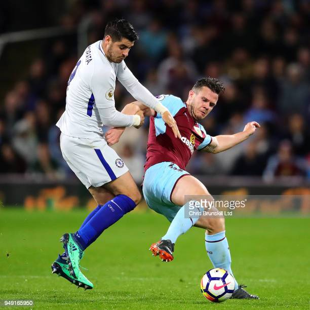 Kevin Long of Burnley in action with Alvaro Morata of Chelsea during the Premier League match between Burnley and Chelsea at Turf Moor on April 19...