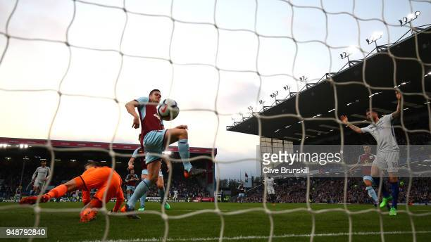 Kevin Long of Burnley scores an own goal during the Premier League match between Burnley and Chelsea at Turf Moor on April 19 2018 in Burnley England