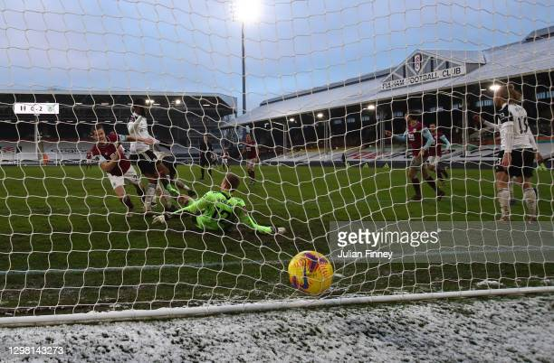Kevin Long of Burnley scores their sides third goal past Marek Rodak of Fulham during The Emirates FA Cup Fourth Round match between Fulham and...