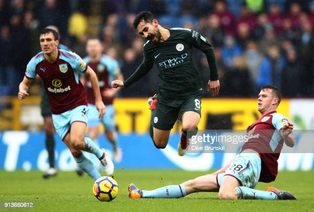 Kevin Long of Burnley tackles Ilkay Gundogan of Manchester City during the Premier League match between Burnley and Manchester City at Turf Moor on...
