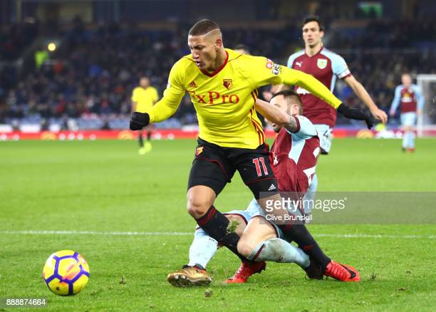 Kevin Long of Burnley tackles Richarlison de Andrade of Watford during the Premier League match between Burnley and Watford at Turf Moor on December...