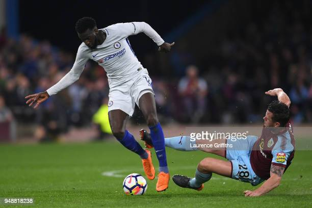 Kevin Long of Burnley tackles Tiemoue Bakayoko of Chelsea during the Premier League match between Burnley and Chelsea at Turf Moor on April 19 2018...