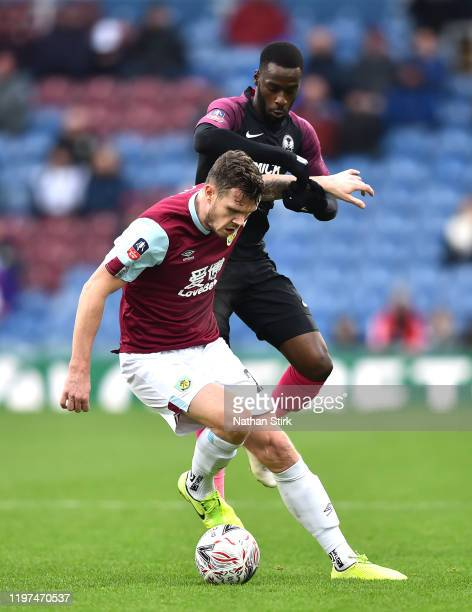 Kevin Long of Burnley turns with the ball under pressure from Mohamed Eisa of Peterborough United during the FA Cup Third Round match between Burnley...