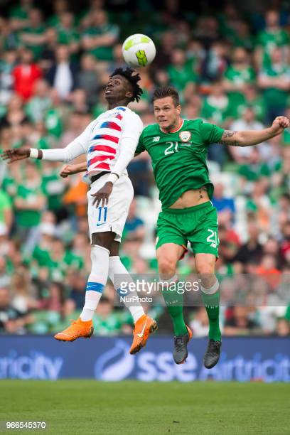 Kevin Long of Ireland jumps with Tim Weah of USA during the International Friendly match between Republic of Ireland and USA at Aviva Stadium in...