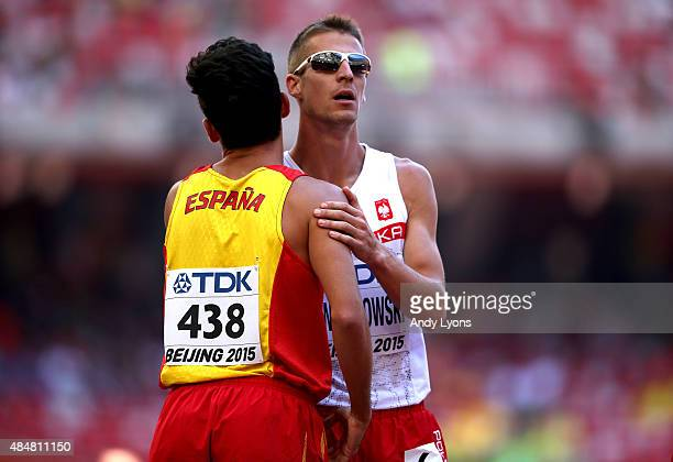 Kevin Lopez of Spain and Marcin Lewandowski of Poland hug after the Men's 800 metres heats during day one of the 15th IAAF World Athletics...