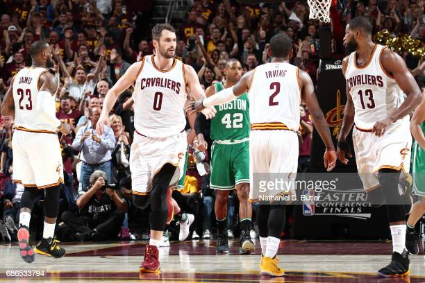 Kevin Love and Kyrie Irving of the Cleveland Cavaliers high five each other during the game against the Boston Celtics in Game Three of the Eastern...