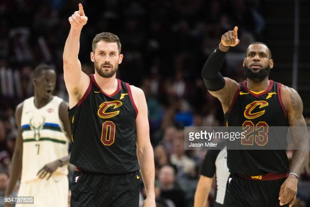 Kevin Love and LeBron James of the Cleveland Cavaliers celebrate after a teammate scored during the second half against the Milwaukee Bucks at...