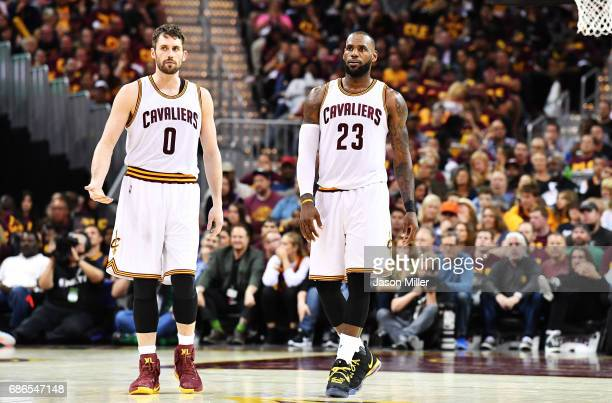 Kevin Love and LeBron James of the Cleveland Cavaliers react in the second half during Game Three of the 2017 NBA Eastern Conference Finals against...