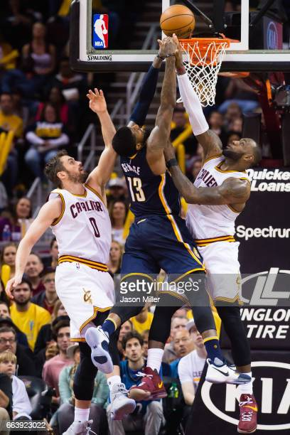Kevin Love and LeBron James of the Cleveland Cavaliers try to stop Paul George of the Indiana Pacers during the first overtime period at Quicken...