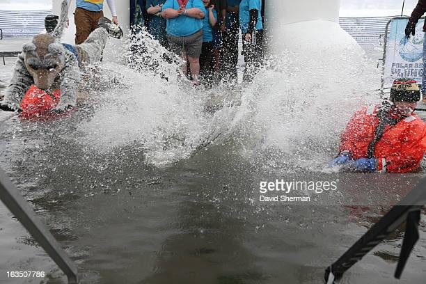 Kevin Love and mascot Crunch of the Minnesota Timberwolves jump into Riley Lake during the Eden Prairie Polar Bear Plunge Presented by Law...