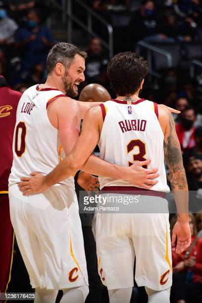 Kevin Love and Ricky Rubio of the Cleveland Cavaliers smile on court against the LA Clippers on October 27, 2021 at STAPLES Center in Los Angeles,...