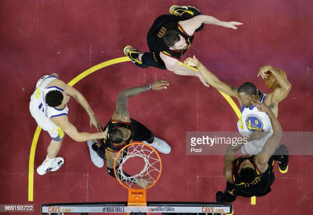 Kevin Love and Tristan Thompson of the Cleveland Cavaliers defend against Andre Iguodala of the Golden State Warriors during Game Three of the 2018...