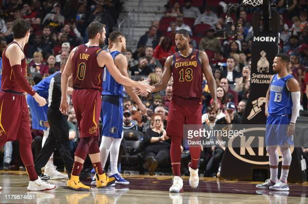 Kevin Love and Tristan Thompson of the Cleveland Cavaliers hifive during a game against the Dallas Mavericks on November 3 2019 at Quicken Loans...