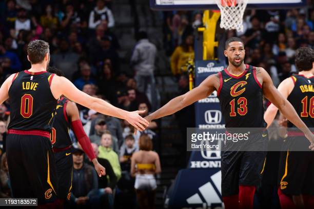 Kevin Love and Tristan Thompson of the Cleveland Cavaliers high five each other during the game against the Denver Nuggets on January 11 2020 at the...