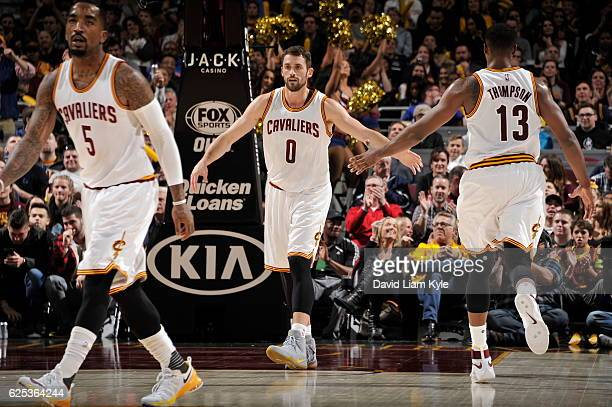 Kevin Love and Tristan Thompson of the Cleveland Cavaliers high five during the game against the Portland Trail Blazers on November 23 2016 at The...