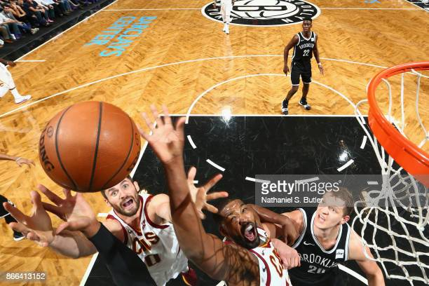 Kevin Love and Tristan Thompson of the Cleveland Cavaliers jump for the rebound against the Brooklyn Nets on October 25 2017 at Barclays Center in...