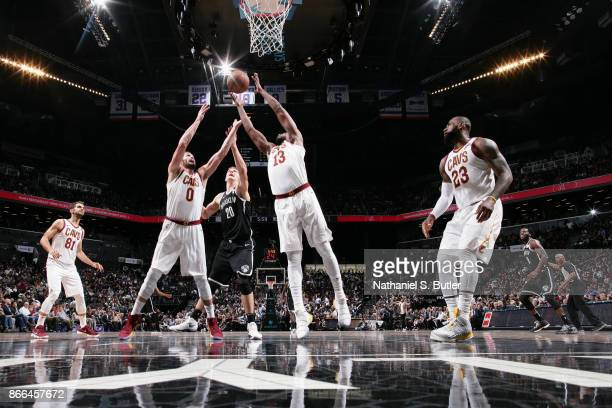 Kevin Love and Tristan Thompson of the Cleveland Cavaliers jump for the rebound on October 25 2017 at Barclays Center in Brooklyn New York NOTE TO...