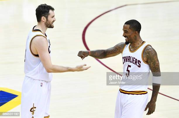Kevin Love celebrates with JR Smith of the Cleveland Cavaliers in the second quarter against the Boston Celtics during Game Three of the 2017 NBA...