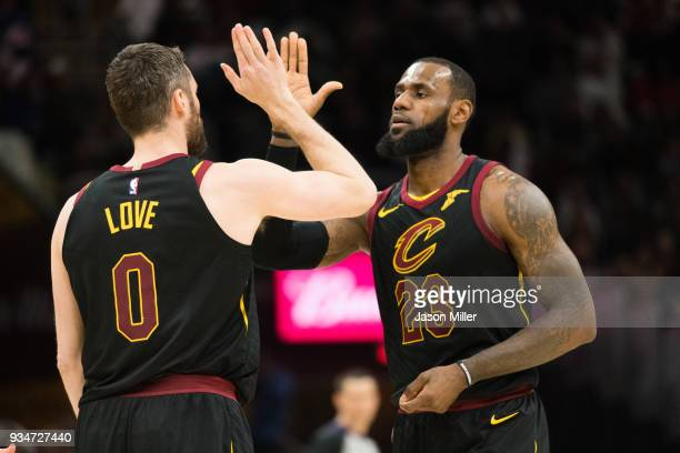 Kevin Love celebrates with LeBron James of the Cleveland Cavaliers after Love scored during the first half against the Milwaukee Bucks half at...