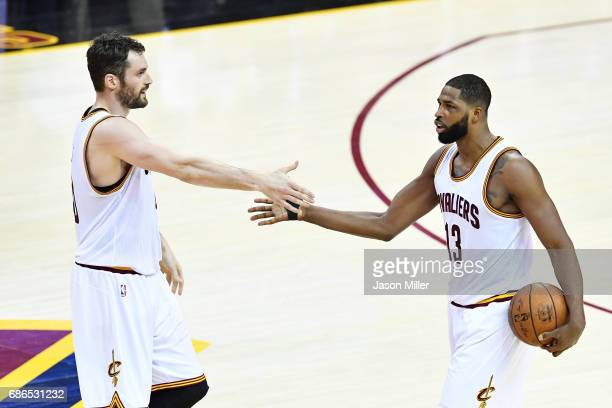 Kevin Love celebrates with Tristan Thompson of the Cleveland Cavaliers in the second quarter against the Boston Celtics during Game Three of the 2017...