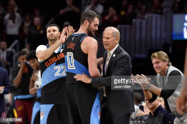 Kevin Love congratulates head coach John Beilein of the Cleveland Cavaliers during the final seconds of the second half against the Indiana Pacers at...