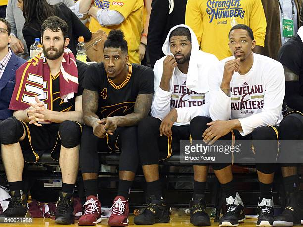 Kevin Love Iman Shumpert Tristan Thompson and Channing Frye of the Cleveland Cavaliers on the bench during the game against the Golden State Warriors...