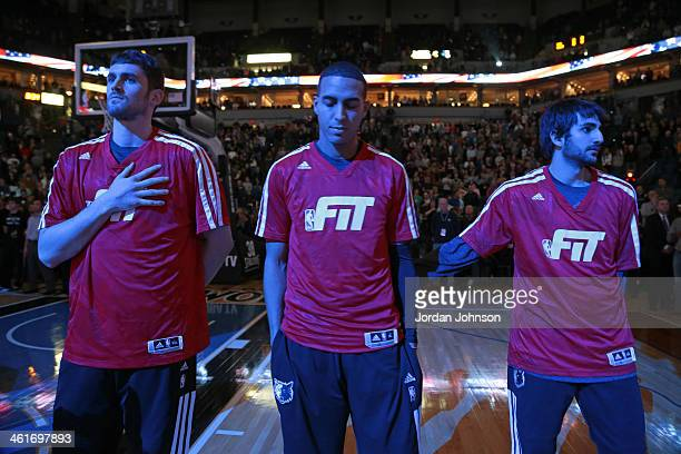 Kevin Love Kevin Martin and Ricky Rubio of the Minnesota Timberwolves stand on the court before the game against the Phoenix Suns on January 8 2014...