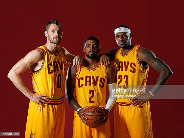 Kevin Love Kyrie Irving and LeBron James of the Cleveland Cavaliers poses for a photo during media day on September 26 2014 at the Cleveland Clinic...