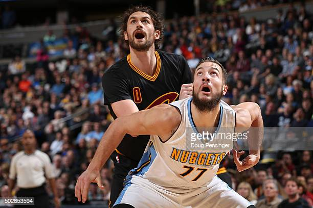 Kevin Love of the Cleveland Cavaliers and Joffrey Lauvergne of the Denver Nuggets battle for rebounding position at Pepsi Center on December 29 2015...