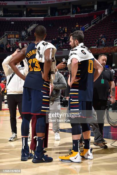 Kevin Love of the Cleveland Cavaliers and Tristan Thompson of the Cleveland Cavaliers talks with the media after the game on March 7 2020 at Rocket...