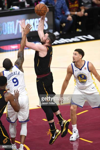 Kevin Love of the Cleveland Cavaliers attempts a shot over Andre Iguodala of the Golden State Warriors in the first half during Game Three of the...