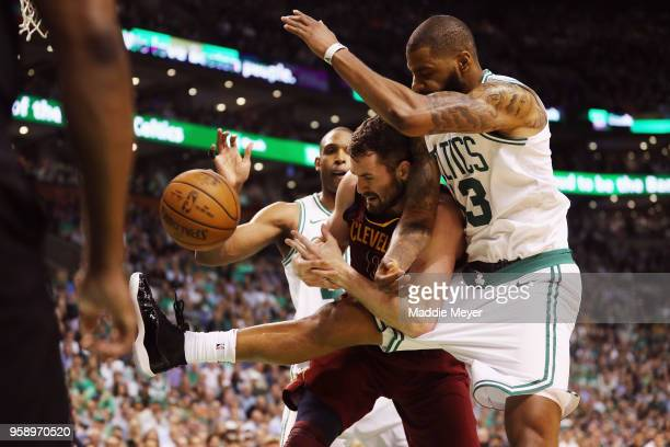 Kevin Love of the Cleveland Cavaliers battles for the ball with Marcus Morris of the Boston Celtics in the first half during Game Two of the 2018 NBA...