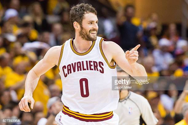 Kevin Love of the Cleveland Cavaliers celebrates after scoring during the second half of the NBA Eastern Conference semifinals against the Atlanta...
