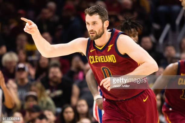 Kevin Love of the Cleveland Cavaliers celebrates after scoring during the first half against the Detroit Pistons at Quicken Loans Arena on January 28...