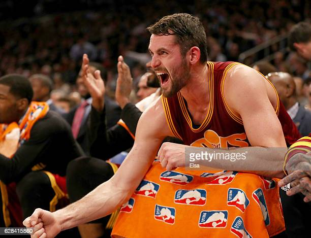 Kevin Love of the Cleveland Cavaliers celebrates from the bench in the second quarter against the New York Knicks at Madison Square Garden on...