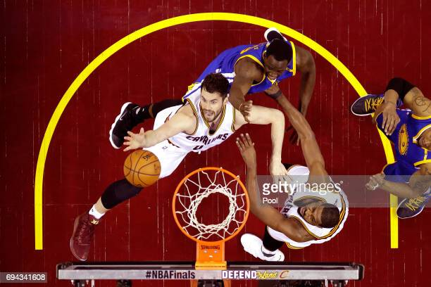 Kevin Love of the Cleveland Cavaliers competes for the ball against Andre Iguodala of the Golden State Warriors in the second quarter in Game 4 of...