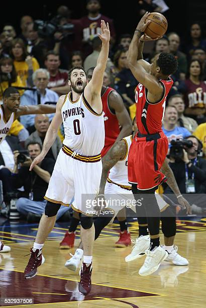 Kevin Love of the Cleveland Cavaliers defends a shot by DeMar DeRozan of the Toronto Raptors during the first half in game two of the Eastern...