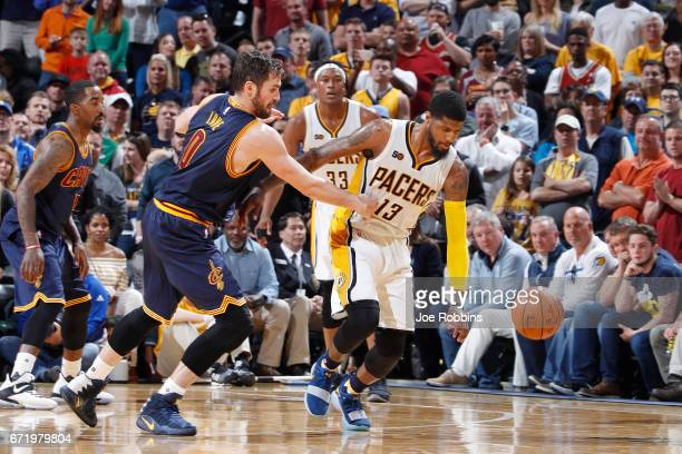 Kevin Love of the Cleveland Cavaliers defends against Paul George of the Indiana Pacers in Game Four of the Eastern Conference Quarterfinals during...