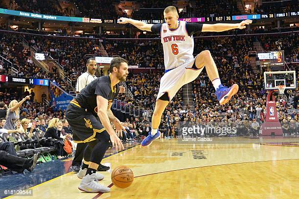 Kevin Love of the Cleveland Cavaliers dekes Kristaps Porzingis of the New York Knicks before sinking a jump shot in the third quarter on October 25...