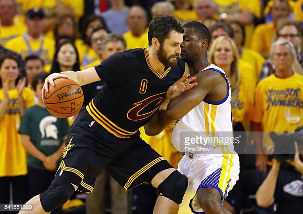 Kevin Love of the Cleveland Cavaliers drives against Harrison Barnes of the Golden State Warriors during the second half in Game 7 of the 2016 NBA...