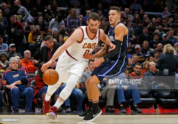 Kevin Love of the Cleveland Cavaliers drives the baseline against Jamel Artis of the Orlando Magic at Quicken Loans Arena on January 18 2018 in...