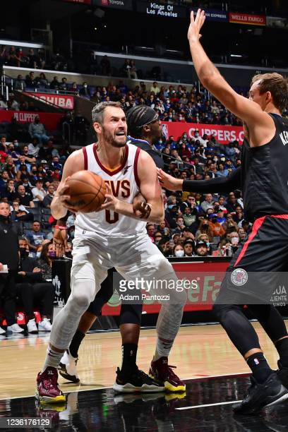 Kevin Love of the Cleveland Cavaliers drives to the basket against the LA Clippers on October 27, 2021 at STAPLES Center in Los Angeles, California....
