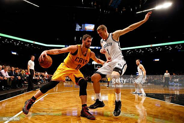 Kevin Love of the Cleveland Cavaliers drives to the basket against Mason Plumlee of the Brooklyn Nets during their game at Barclays Center on...
