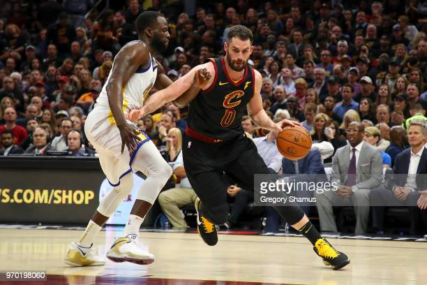 Kevin Love of the Cleveland Cavaliers drives to the basket against Draymond Green of the Golden State Warriors during Game Four of the 2018 NBA...