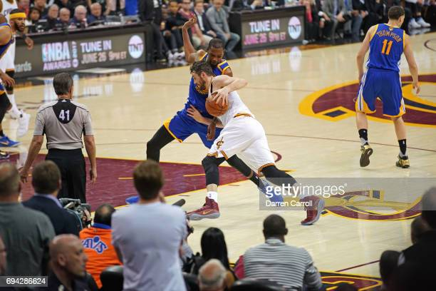 Kevin Love of the Cleveland Cavaliers drives to the basket while guarded by Kevin Durant of the Golden State Warriors in Game Three of the 2017 NBA...