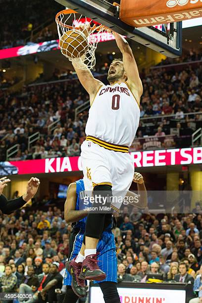 Kevin Love of the Cleveland Cavaliers dunks against the Orlando Magic during the second half at Quicken Loans Arena on November 24, 2014 in...